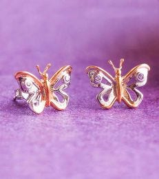 Sterling Silver Butterfly Stud Earrings Front View in Pink Background