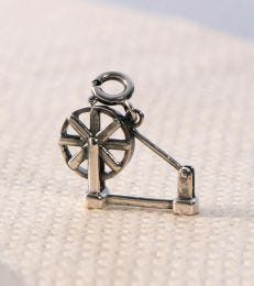 fourseven charkha charm in sterling silver