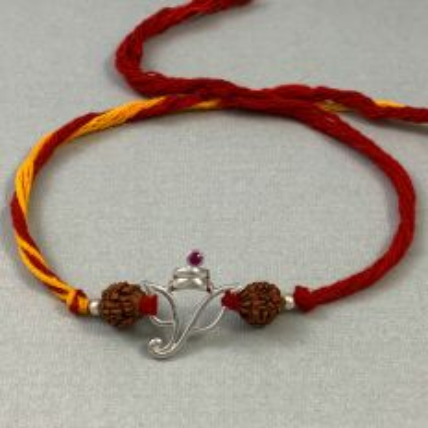 Silver Ganesha Pendant with Rudraksha Moli Rakhi Bracelet  by Fourseven