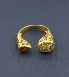 Gold Plated Abha Ring in Golden Topaz and Garnet alternate view