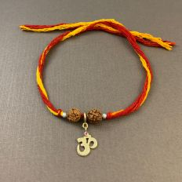 Om Charm in Gold with Rudraksha Moli Rakhi Bracelet