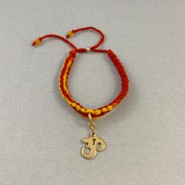 Adjustable Moli Rakhi Bracelet with Silver Om Charm in Gold