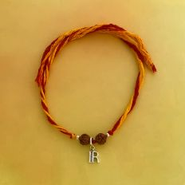 Silver Letter R Charm with Rudraksha Moli Rakhi Bracelet