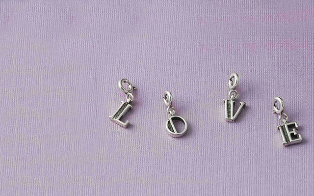 Alphabet charms in silver