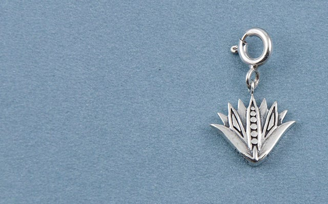 Blue lotus charm in silver
