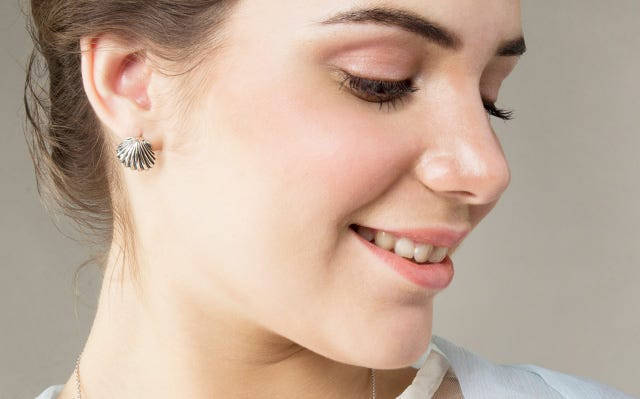 Girl wearing Sounds of the Sea Shell Stud Earrings