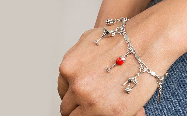 Simply charming bracelet with just for fun charms in silver