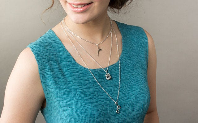 Layered necklace with charms in silver