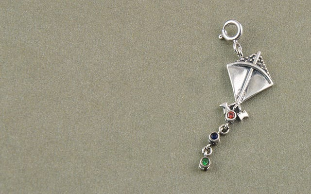 Silver Let's Go fly a kite charm