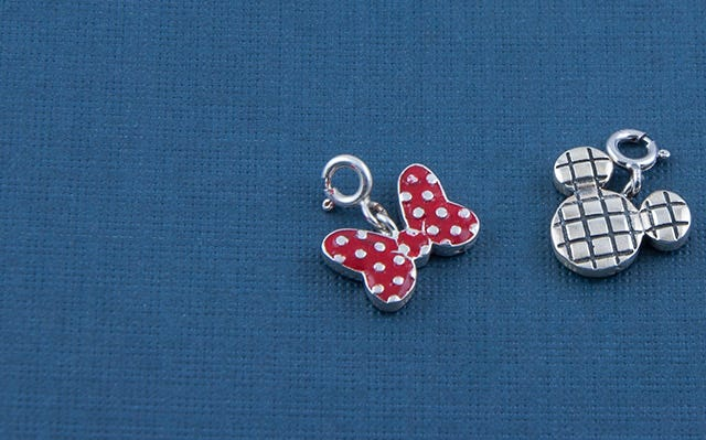 Mickey mouse and Minnie mouse charms in silver