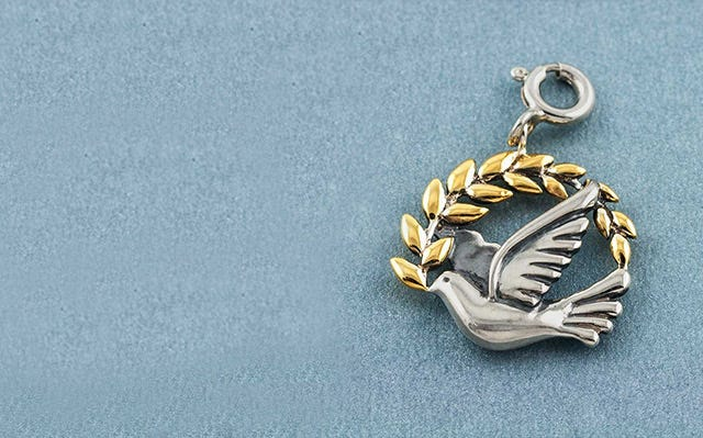 Peace dove charm in silver
