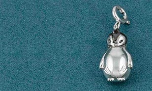 Just chillin' penguin charm in silver