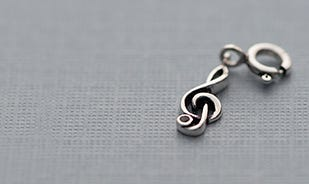 Musical clef charm in silver
