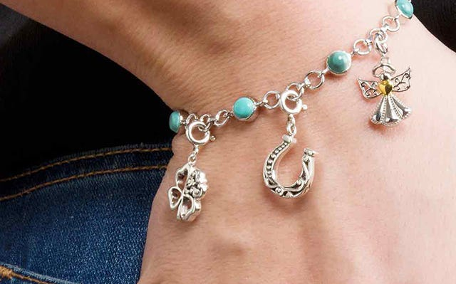Turquoise charm bracelet with good luck charms in silver