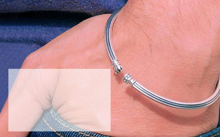 Roots and wings cuff bangle in silver
